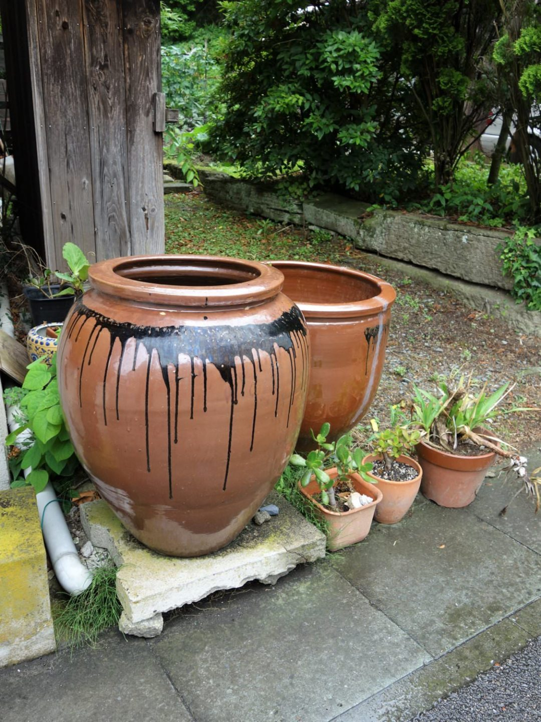 Water jugs along the street of Omori district