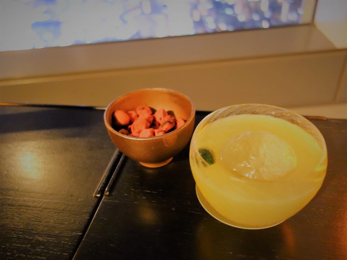 """Kiyohime Amazake"" cocktail with sweet plum snack"
