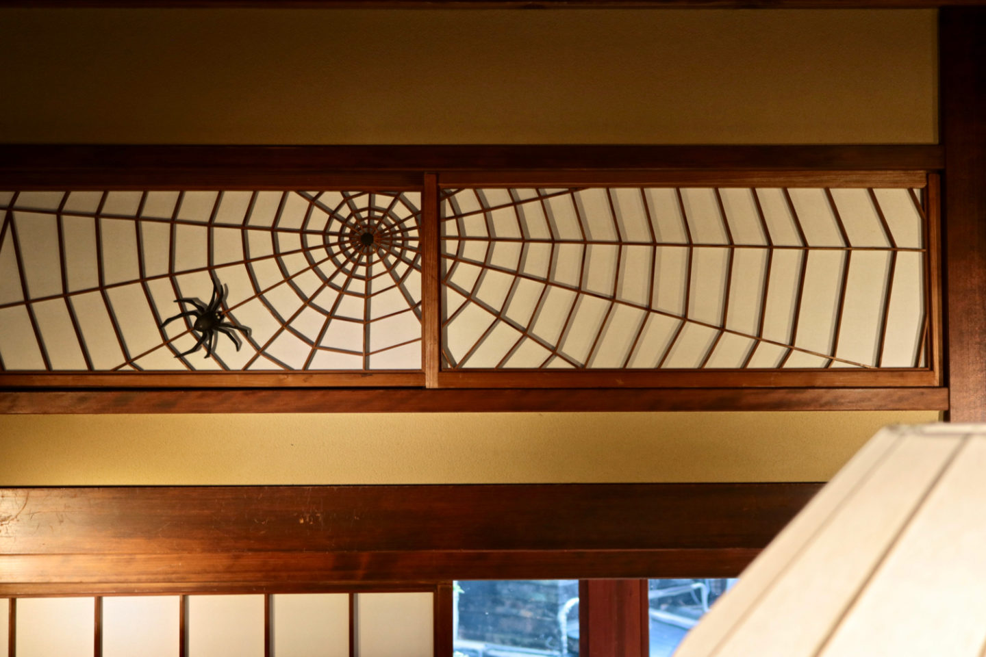 """""""Ranma"""" transom panels depicting spiders and spider webs"""