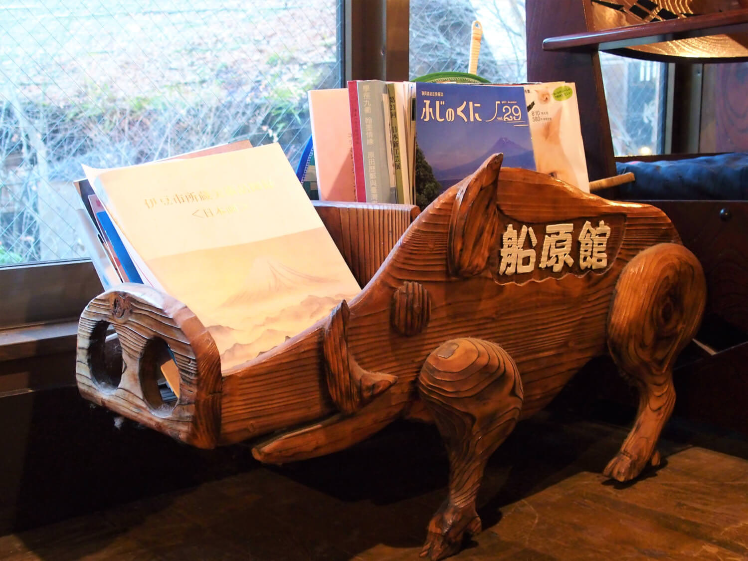 A book stand shaped like a boar