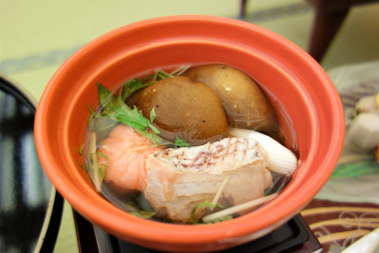 A soup with sea bream, seaweed, vegetables and shrimp mochi