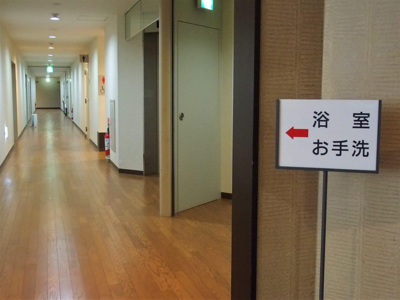 A hallway leading to bathrooms and public baths