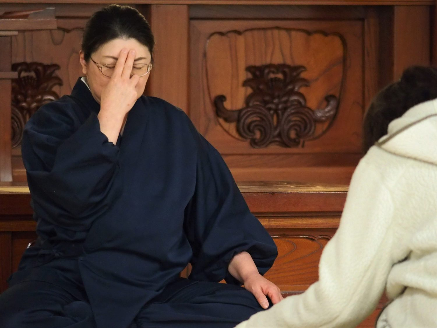 Being taught how to meditate by a female monk